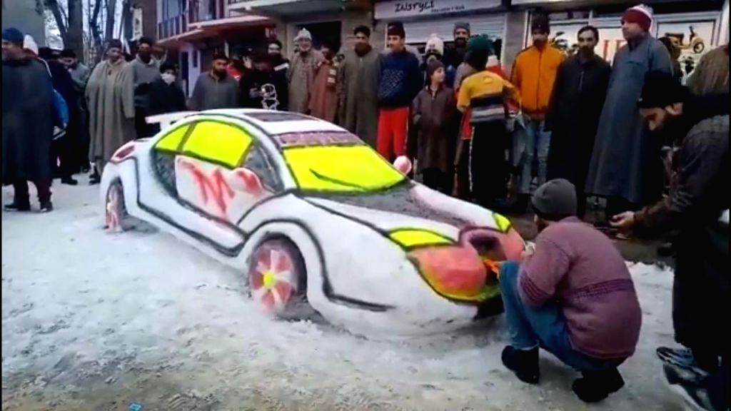 Video of a Kashmiri Youth, named Zubair Ahmed from Budgam district is making rounds of the Internet, who made a supercool 'snow car.' It took him two days to finish it. The car is so beautiful that the citizens were captured taking pictures and selfi