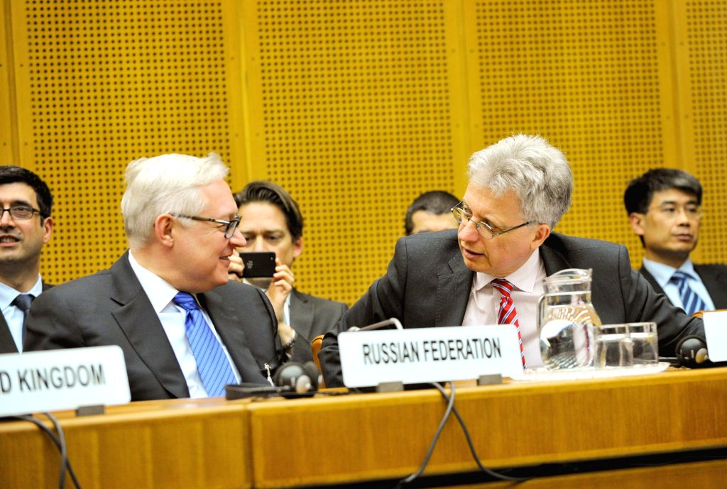 Russian Deputy Foreign Minister Sergei Ryabkov (L) attends the closing session of the third round discussion on Iran's nuclear program in Vienna April 9, 2014. Iran . - Sergei Ryabkov