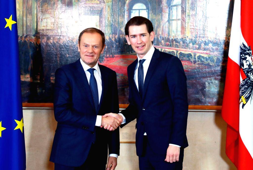 VIENNA, Feb. 13, 2018 - Austrian Chancellor Sebastian Kurz (R) shakes hands with visiting European Council President Donald Tusk in Vienna, Austria, on Feb. 13, 2018. European Council President ...