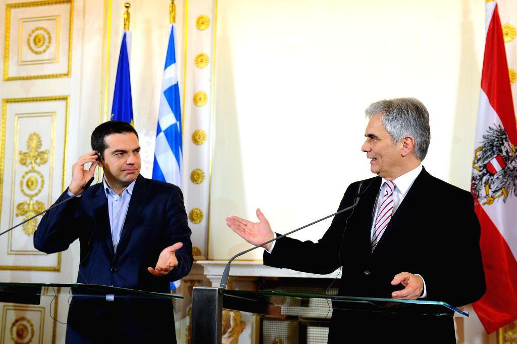 Austrian Chancellor Werner Faymann (R) and Greece's Prime Minister Alexis Tsipras attend a joint press briefing after their meeting in Vienna, capital of Austria, on . - Alexis Tsipras