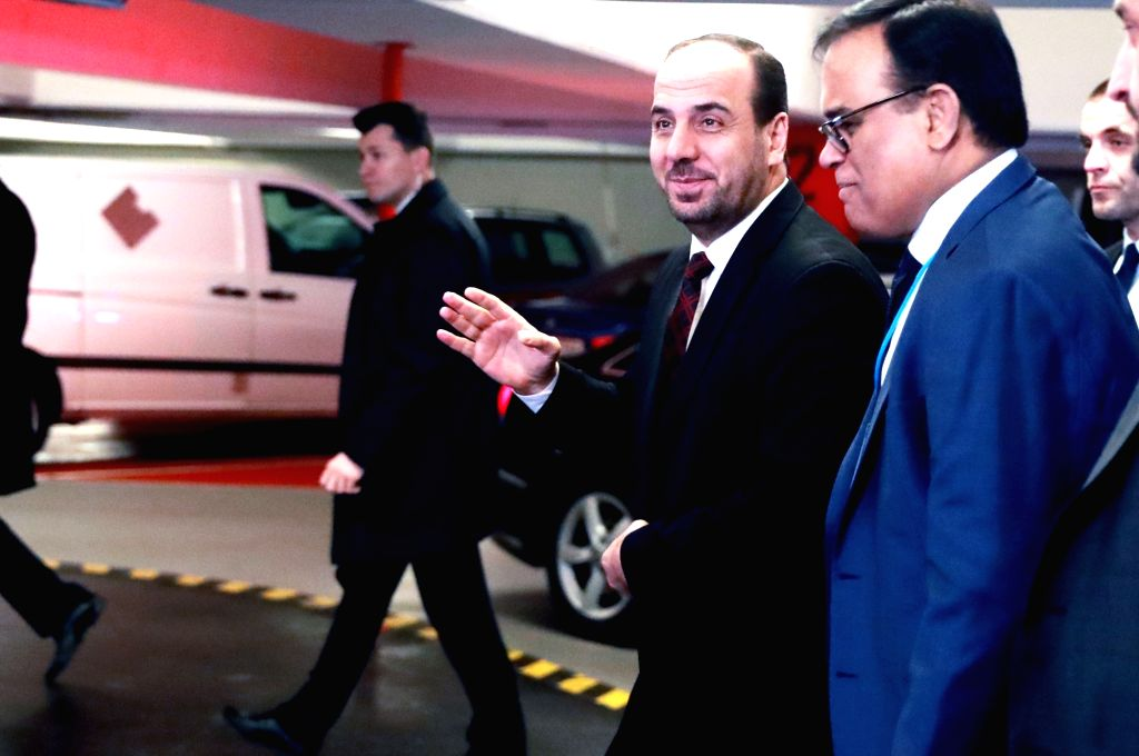 VIENNA, Jan. 25, 2018 - Nasr al-Hariri (2nd L), head of the Syrian opposition delegation, arrives for Syrian peace talks in Vienna, Austria, on Jan. 25, 2018. Syrian peace talks organized by the ...