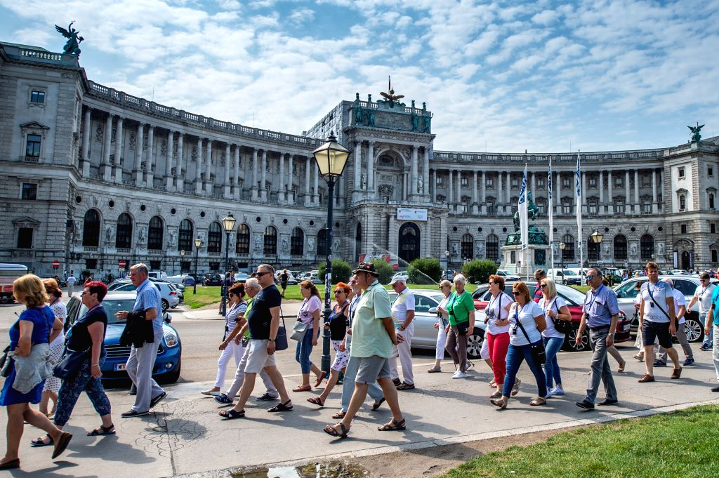 VIENNA, July 19, 2019 (Xinhua) -- Tourists visit the inner city of Vienna, Austria, on July 19. During the summer vacation in Europe, Vienna attracts tourists from around the world with its unique architecture and beautiful scenery. (Xinhua/Guo Chen/