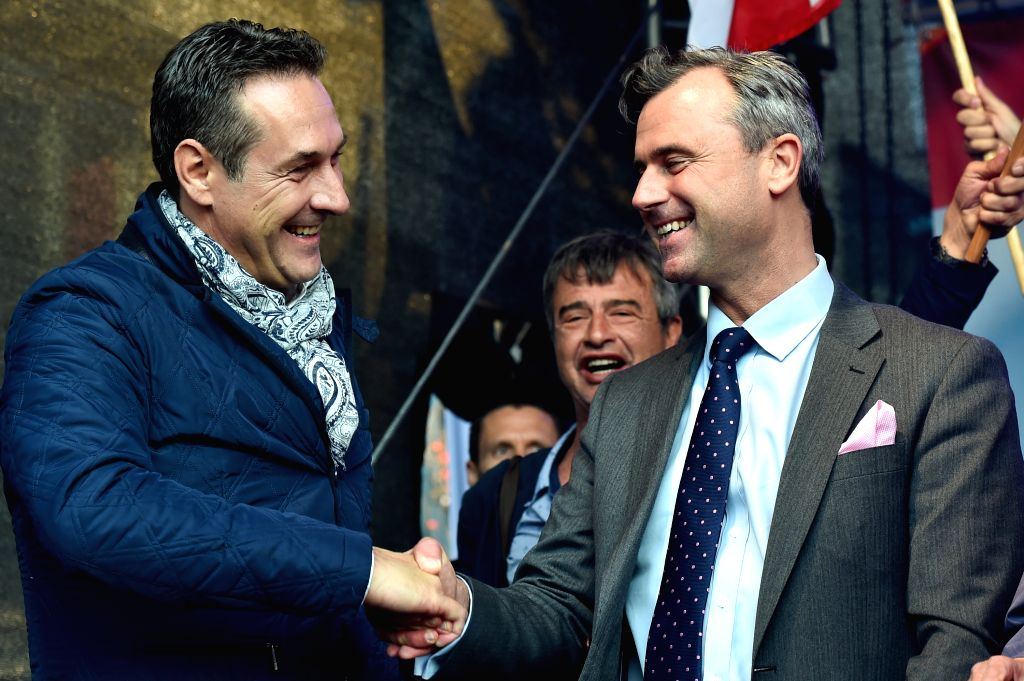 VIENNA, May 20, 2016 - Norbert Hofer (R), candidate for presidential elections of Austria's Freedom Party, shakes hands with Heinz-Christian Strache, head of Austria's Freedom Party during the final ...