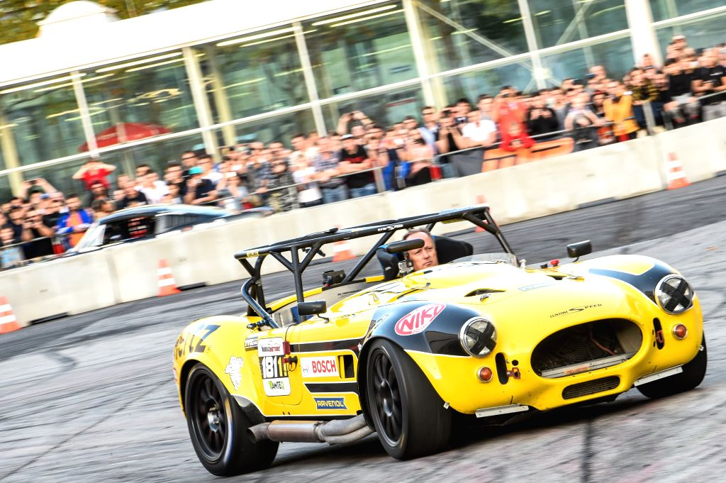 VIENNA, Oct. 27, 2019 - A modified car performs stunts at the Custom Wheels Vienna in Vienna, Austria, Oct. 27, 2019. As an event for customizing, performance and motorsport in Vienna, the Custom ...