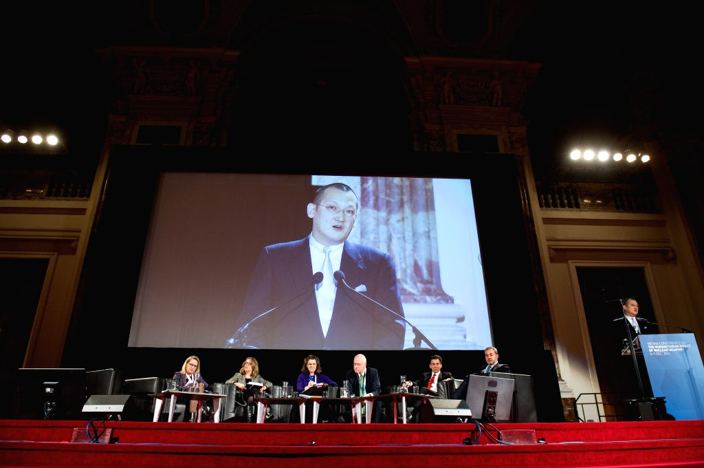 Vienna : Representatives have a discussion at the Vienna Conference on the Humanitarian Impact of Nuclear Weapons held in Vienna, capital of Austria, Dec. 9, 2014. The two-day Vienna Conference on ...