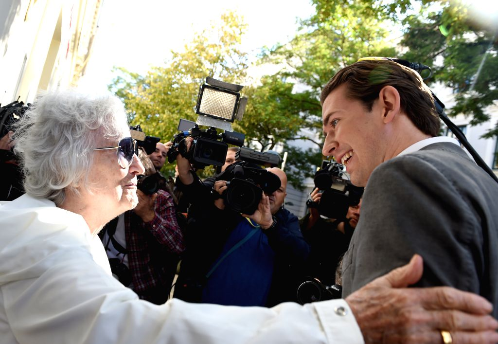 VIENNA, Sept. 29, 2019 - Sebastian Kurz (R), chairman of the Austrian People's Party, talks to a senior citizen in front of a polling station in Vienna, Austria, Sept. 29, 2019. Polling booths opened ...