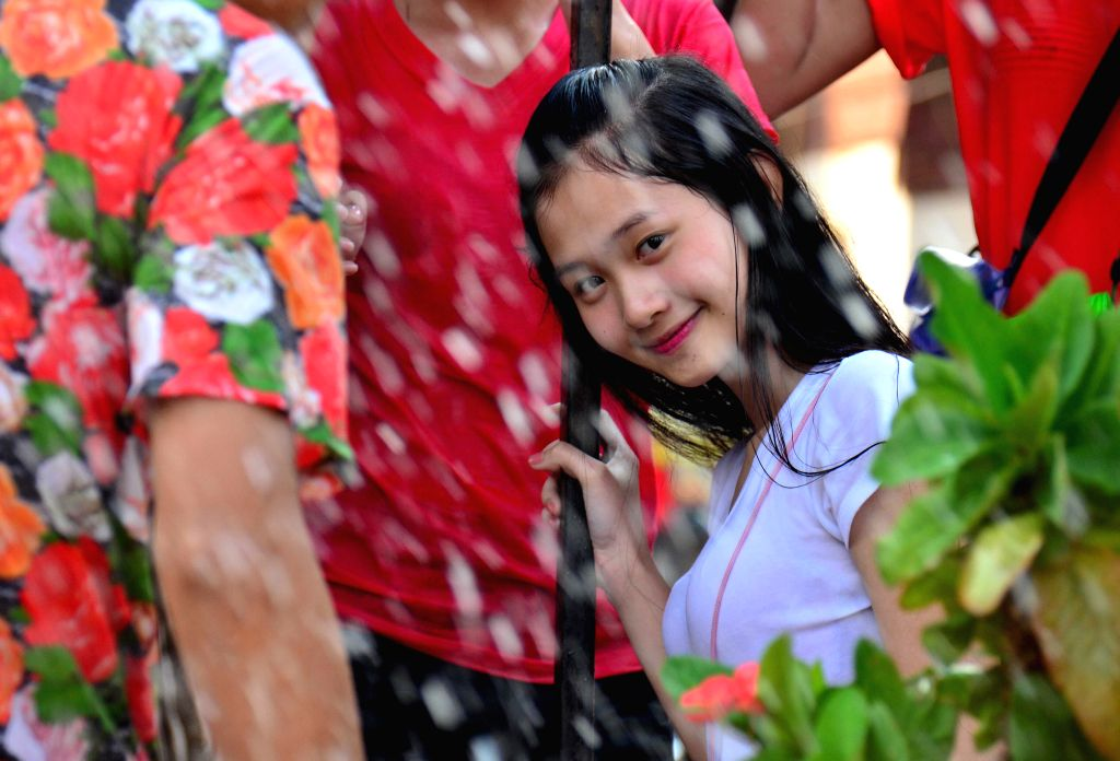 VIENTIANE, April 12, 2016 - A girl takes part in water-splashing battles held in Vientiane, Laos, April 12, 2016. People celebrated the water-splashing festival or the traditional New Year from April ...