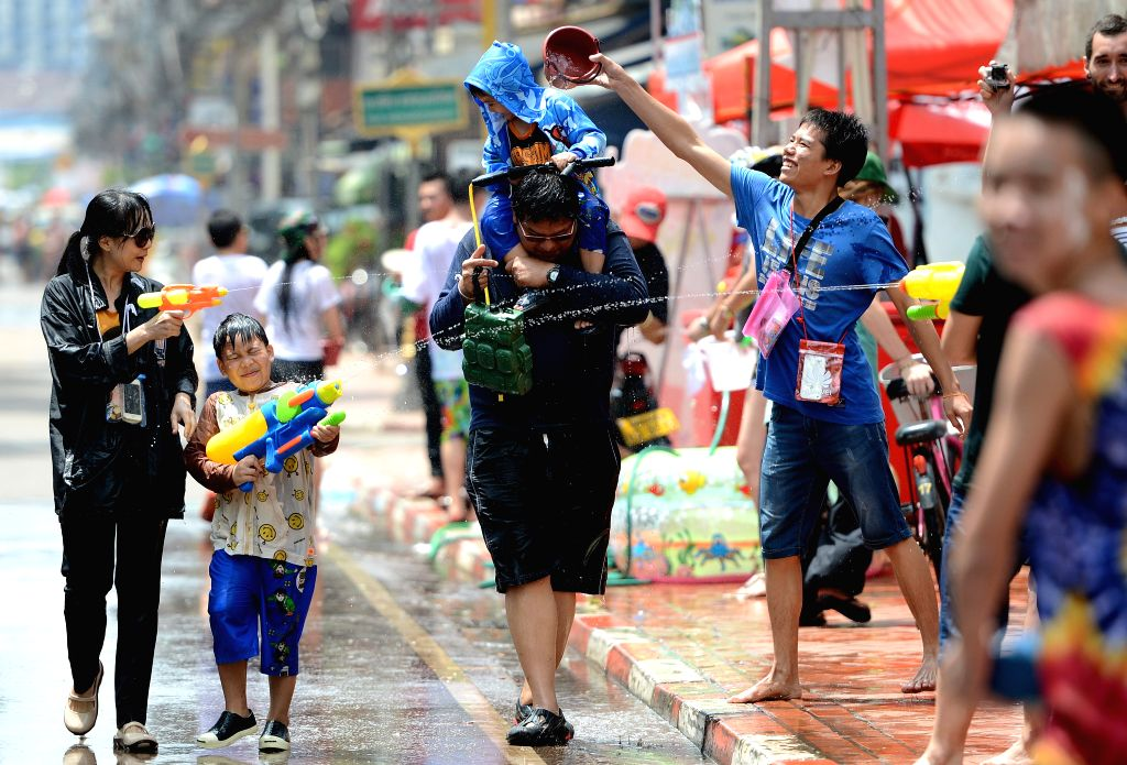 People take part in water-splashing battles in Vientiane, Laos, April 14, 2015. People celebrated the water-splashing festival or the traditional New Year from ...
