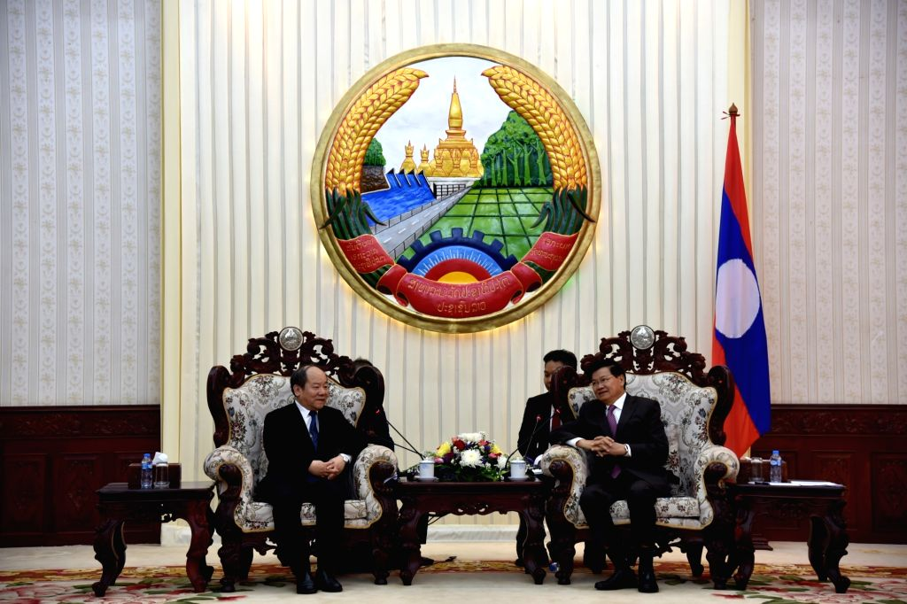 VIENTIANE, Feb. 21, 2019 - Ning Jizhe (L, Front), deputy head of China's National Development and Reform Commission, meets with Lao Prime Minister Thongloun Sisoulith (R, Front) in Vientiane, Laos, ... - Thongloun Sisoulith
