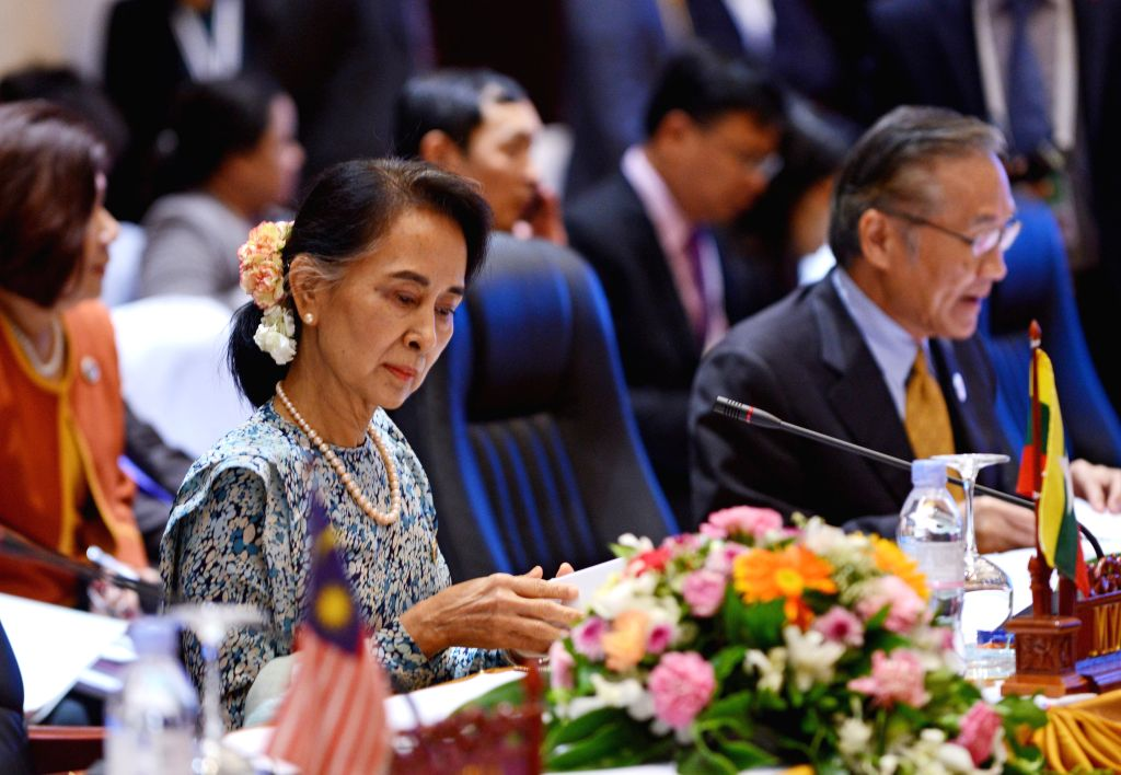 VIENTIANE, July 25, 2016 - Myanmar State Counselor and Foreign Minister Aung San Suu Kyi (L) attends the meeting between Chinese Foreign Minister Wang Yi and his counterparts from 10 members of the ... - Aung San Suu Kyi