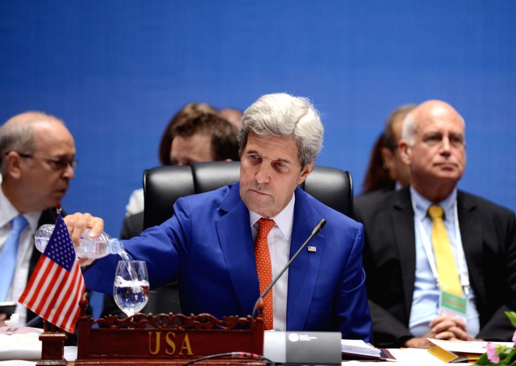 VIENTIANE, July 25, 2016 - U.S. Secretary of State John Kerry pours water into his cup during the 9th Lower Mekong Initiative Ministerial Meeting in Vientiane, Laos, July 25, 2016. Lao Foreign ... - Saleumxay Kommasith