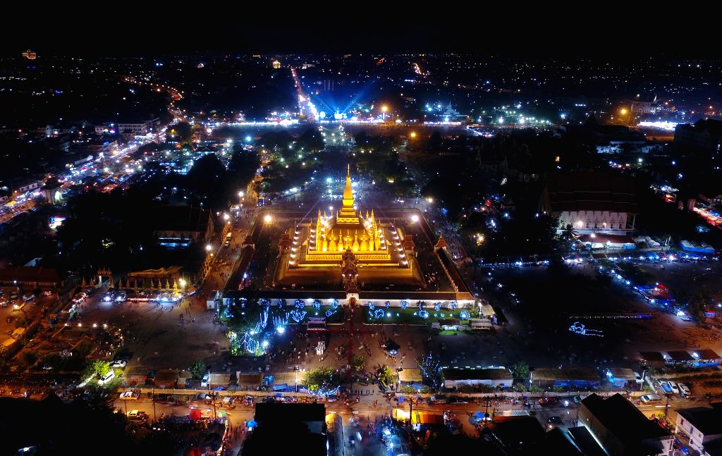 "VIENTIANE, Nov. 13, 2016 - Photo taken on Nov. 12, 2016 by a drone shows the night view of That Luang Stupa or ""Pha That Luang"" in Vientiane, Laos, Nov. 12, 2016. That Luang festival, Laos' ..."
