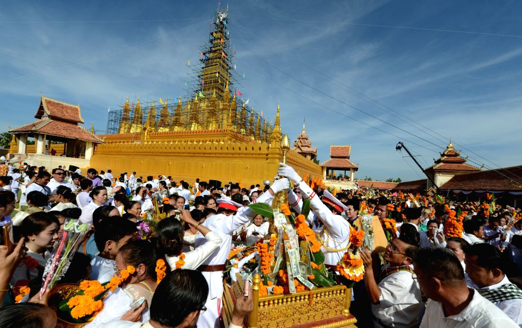 VIENTIANE, Oct. 31, 2016 - People gather at Pha That Luang in Vientiane, capital of Laos, Oct. 31, 2016. A completion ceremony of the reconstruction of Pha That Luang was held Monday in Vientiane. ...