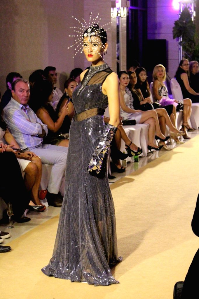 VIENTIANE, Sept. 17 A model displays a creation on the runway during the Lao Fashion Week 2016 in Vientiane, capital of Laos, Sept. 15, 2016. The Lao Fashion Week 2016 was held from Sept. ...