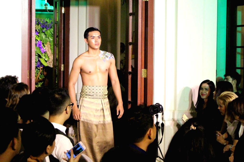 VIENTIANE, Sept. 17 A model displays a creation on the runway during the Lao Fashion Week 2016 in Vientiane, capital of Laos, Sept. 13, 2016. The Lao Fashion Week 2016 was held from Sept. ...