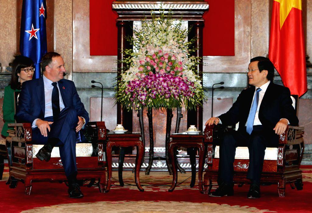 Vietnamese President Truong Tan Sang (R) meets with New Zealand's Prime Minister John Key in Hanoi, capital of Vietnam, on Nov. 16, 2015. John Key started a four-day ... - John Key