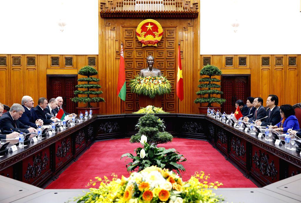 Vietnamese Prime Minister Nguyen Tan Dung (2nd R) meets with Belarusian President Alexander Lukashenko (2nd L) in Hanoi, capital of Vietnam, Dec. 9, 2015. Lukashenko ... - Nguyen Tan Dung