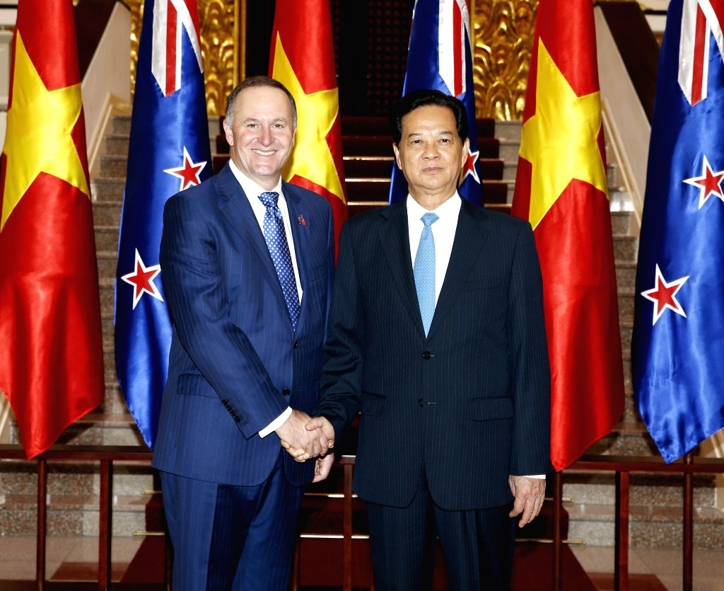 Vietnamese Prime Minister Nguyen Tan Dung (R) shakes hands with New Zealand's Prime Minister John Key in Hanoi, capital of Vietnam, Nov. 15, 2015. John Key is on an ... - Nguyen Tan Dung