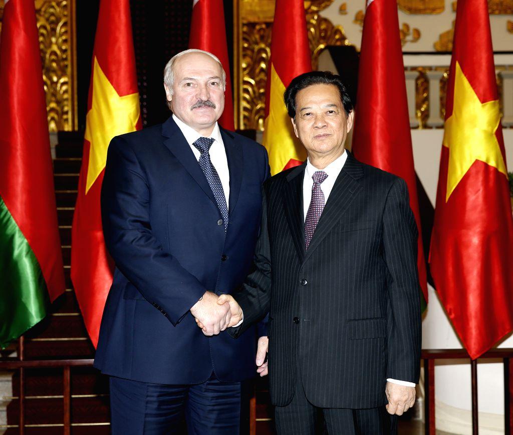 Vietnamese Prime Minister Nguyen Tan Dung (R) shakes hands with Belarusian President Alexander Lukashenko in Hanoi, capital of Vietnam, Dec. 9, 2015. Lukashenko is ... - Nguyen Tan Dung