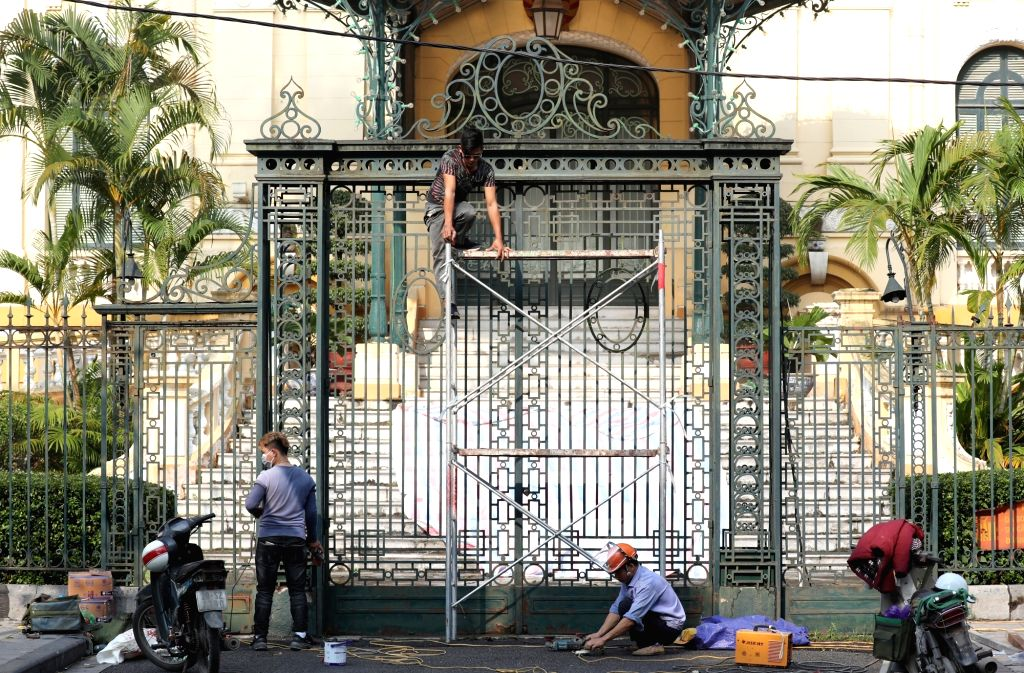 Vietnamese workers conduct repair work on the state guesthouse in Hanoi on Feb. 18, 2019, in preparation for a second U.S.-North Korean summit slated for Feb. 27-28.