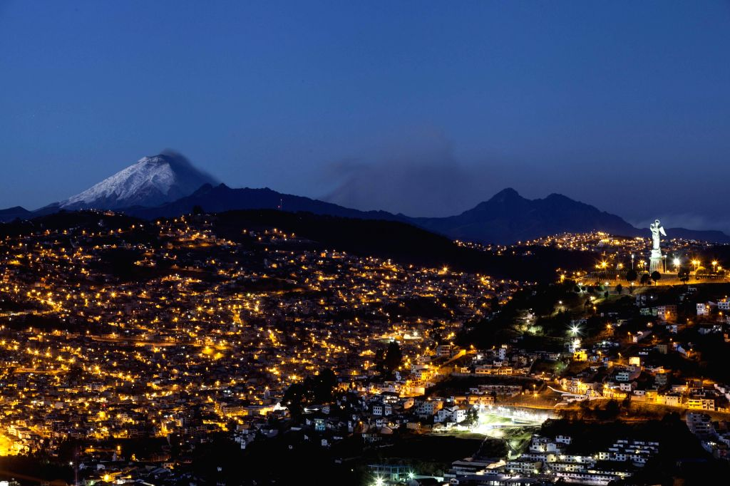 View of volcano Cotopaxi (L) spelling ashes in a photo taken from Quito, Ecuador, 18 August 2015. The volcano spelled ashes lightly and the authorities keep the yellow alert since last 14 August. ...