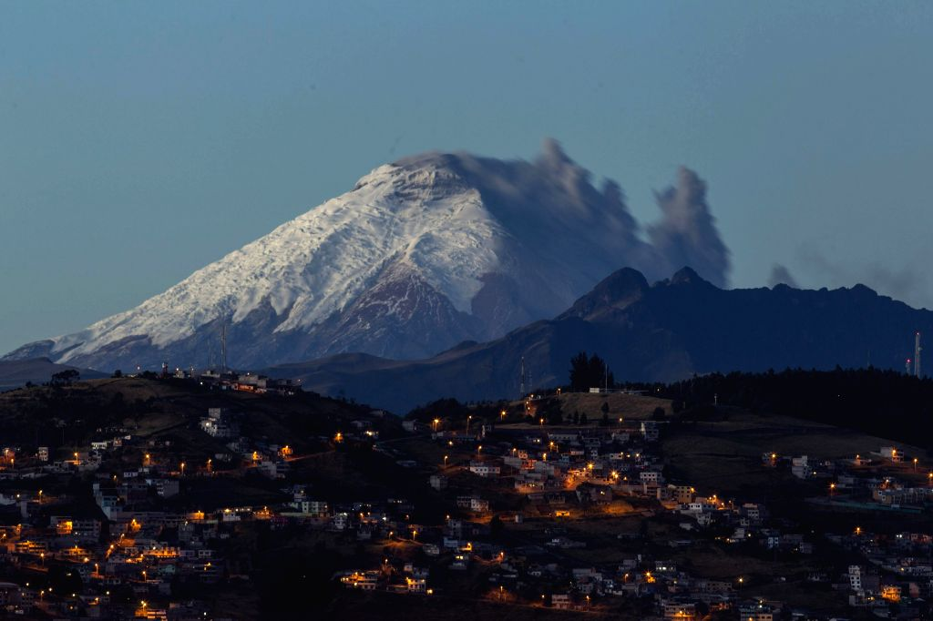 View of volcano Cotopaxi spelling ashes in a photo taken from Quito, Ecuador, 18 August 2015. The volcano spelled ashes lightly and the authorities keep the yellow alert since last 14 August. ...