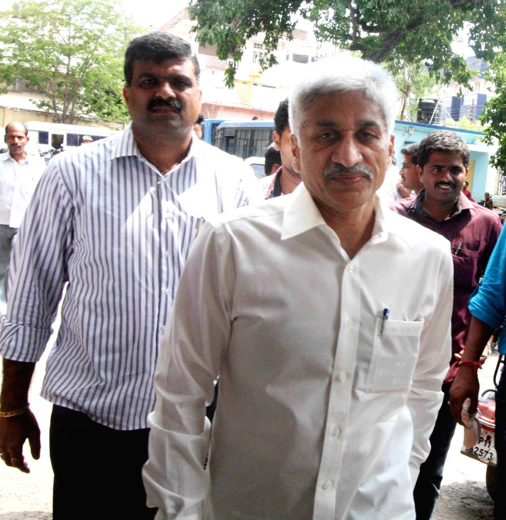 Vijay Sai Reddy, the vice chairman of Jagati Publications, owned by YSR Congress chief Jaganmohan Reddy surrendered before the CBI court as per Supreme Court order on June 5, 2013. (Photo: IANS) - Vijay Sai Reddy and Jaganmohan Reddy