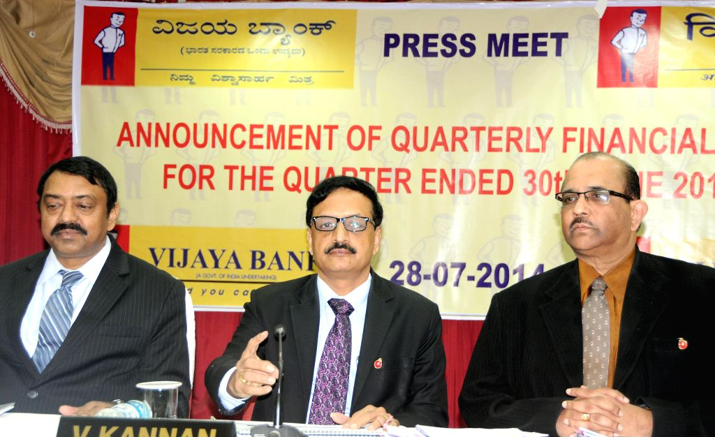 Vijaya Bank Chairman and Managing Director, V Kannan with bank's Executive Directors BS Rama Rao and K Ramadas Shenoy during a press conference to announce Q1 financial results in Bangalore on July .. - Rao