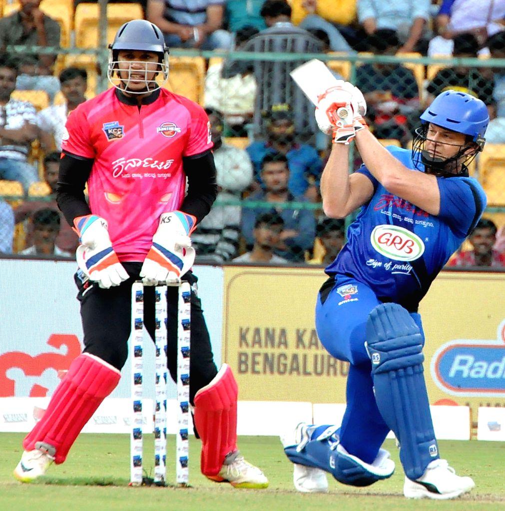 Vijayanagara Patriots' Adam Gilchrist in action during Kannada Chalanachitra Cup at M. Chinnaswamy Stadium, in Bengaluru on Sept 8, 2018.