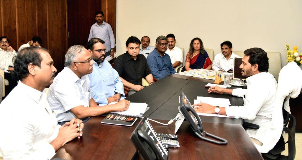 Vijayawada: A delegation of representatives from Azim Premji Foundation call on Andhra Pradesh Chief Minister Y.S. Jagan Mohan Reddy in Vijayawada, on July 26, 2019. (Photo: IANS) - Y.