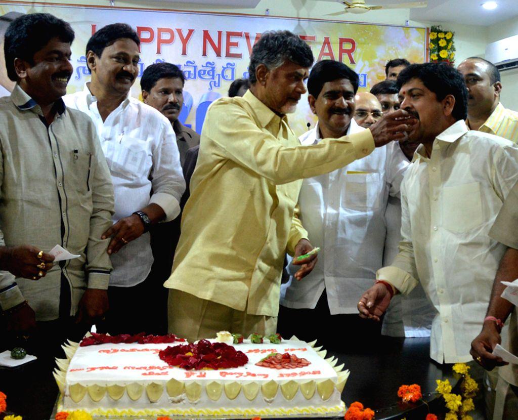 Andhra Pradesh Chief Minister N. Chandrababu Naidu celebrates new year in Vijayawada, Andhra Pradesh on Jan 1, 2015. - N. Chandrababu Naidu