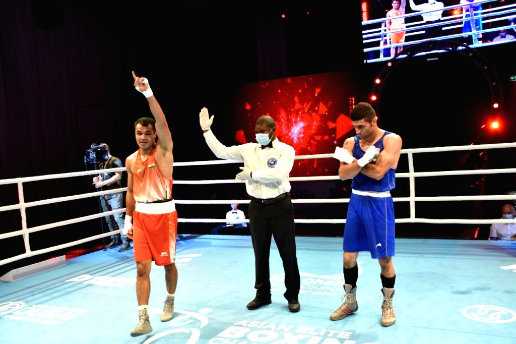 Vikas Krishan (69kg) defeated Iran's Moslem Maghsoudi Mal Amir 4-1 in the quarter Final  to secure atleast a bronze medal.