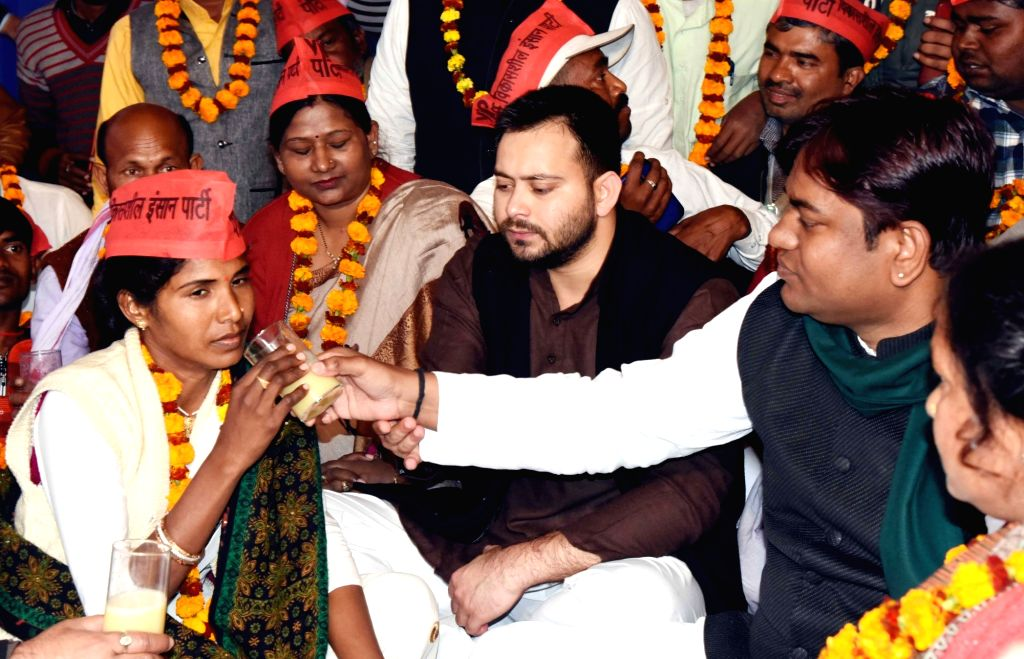 Vikassheel Insaan Party (VIP) chief Mukesh Sahni accompanied by RJD leader Tejashwi Yadav, breaks the fast of party workers who were on a hunger strike to protest against a ban on fish sales ... - Tejashwi Yadav