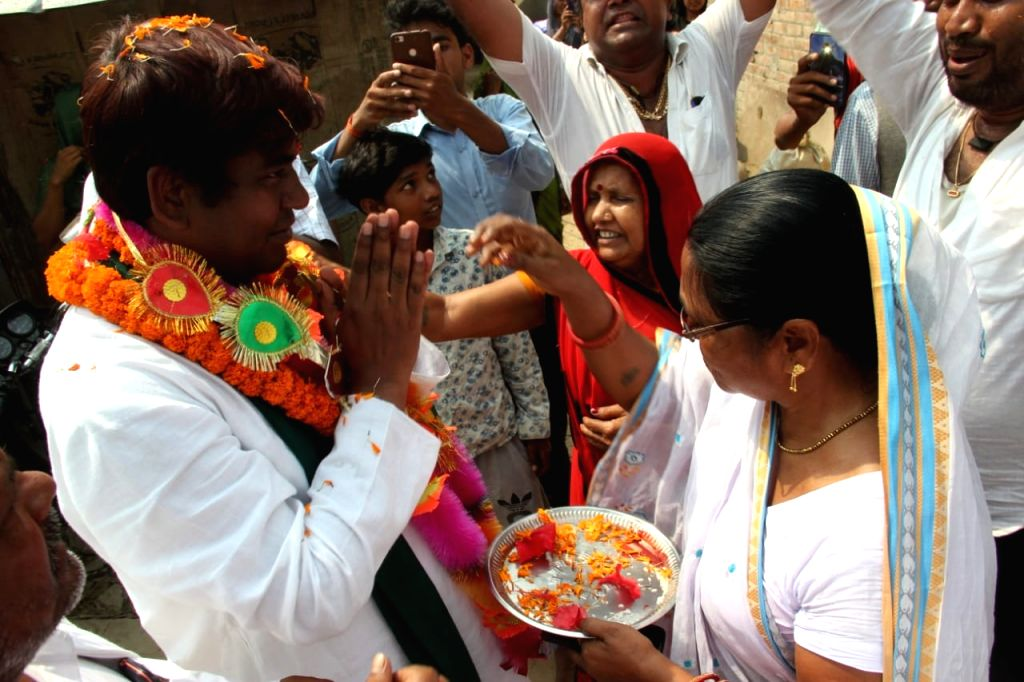 Vikassheel Insan Party (VIP) chief and the Grand Alliance's Lok Sabha candidate from Khagaria, Mukesh Sahni being greeted by supporters during a roadshow in Bihar's Khagaria, on April 13, ...