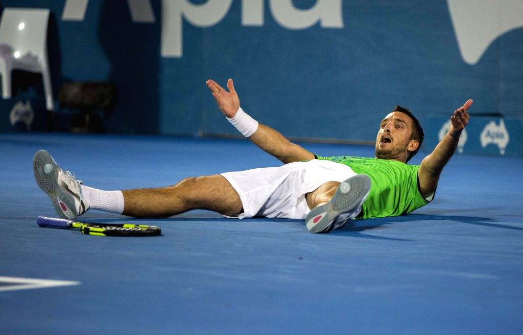 Viktor Troicki of Serbia celebrates for victory after winning the men's singles final against Grigor Dimitrov of Bulgaria at the Apia International Sydney tennis ...