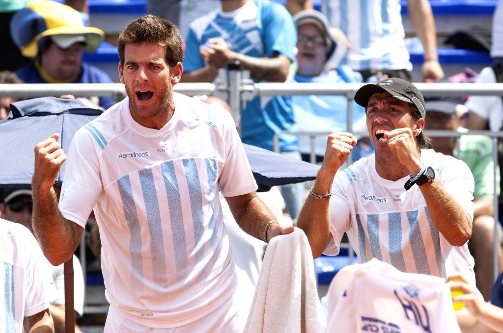 Juan Martin del Potro (L) and Carlos Berlocq of Argentina celebrate after the match between Federico Delbonis of Argentina and Thomaz Bellucci of Brazil at ...