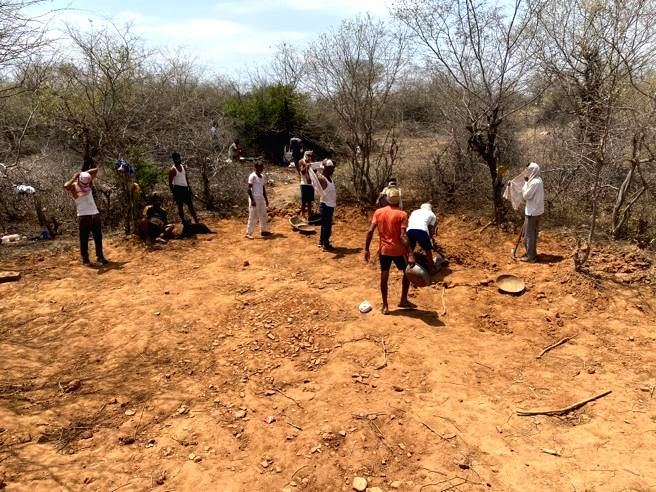 Village youths dig water hole for animals amid lockdown.