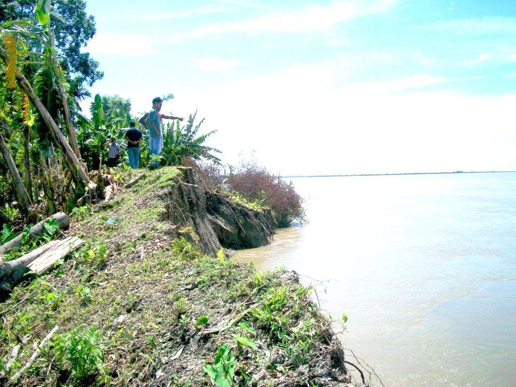 Villagers are forced to shift from their village after heavy erosion caused by Rising water of the Brahmaputra River has eaten up most of their land in the Dyani village area near Neemati Ghat in ...