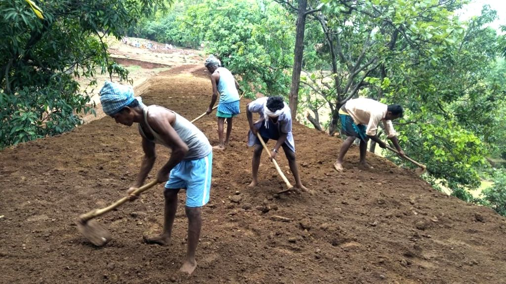 Villagers busy in the construction of rain water harvesting system at Aara village in Ormanjhi near Ranchi. Prime Minister Narendra Modi lauded the efforts of Jharkhand's twin villages of ... - Narendra Modi