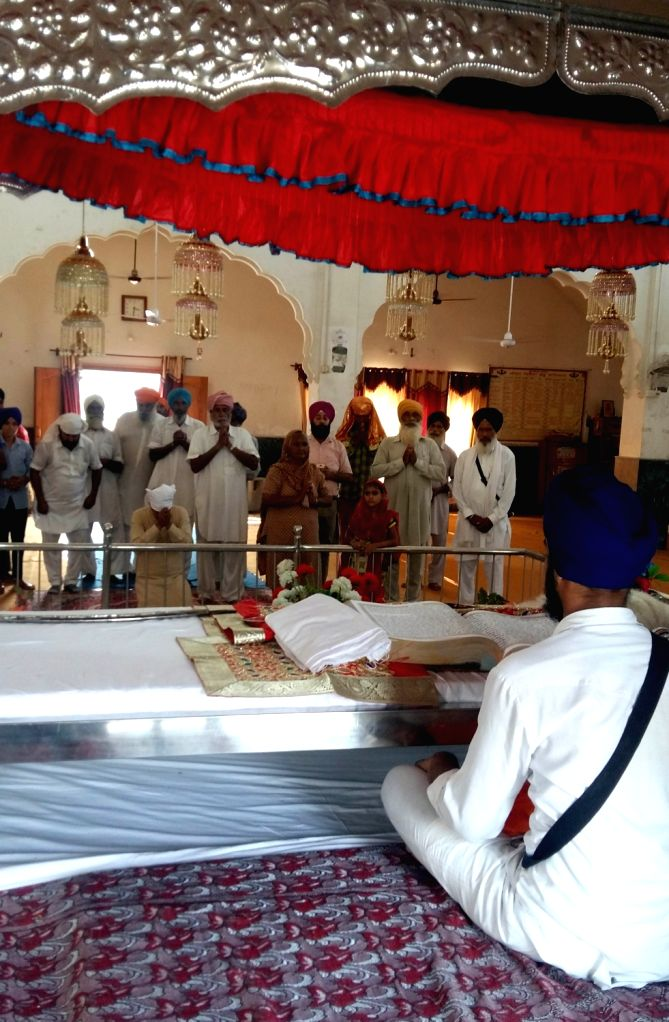 Villagers offer prayers at a Gurudwara in Atari of Punjab after successful surgical strikes carries out by the Indian Army across the LoC on Sept 30, 2016.