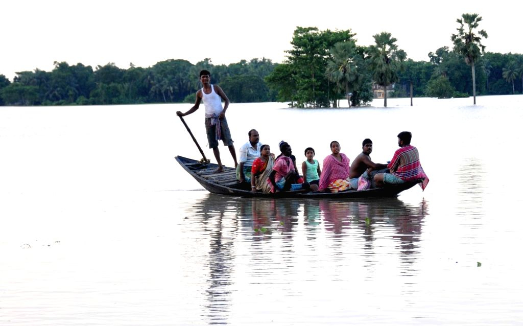 Villagers use boat for travel in flood affected area in Howrah District West Bengal on Sunday october 03, 2021.