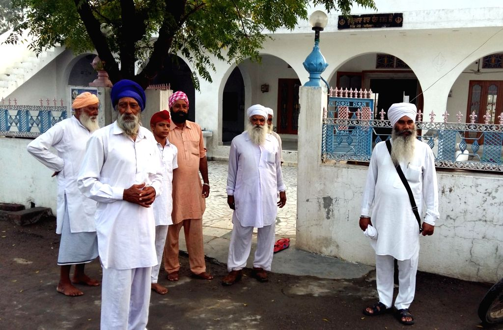 Villagers visit a Gurudwara in Atari of Punjab after successful surgical strikes carries out by the Indian Army across the LoC on Sept 30, 2016.