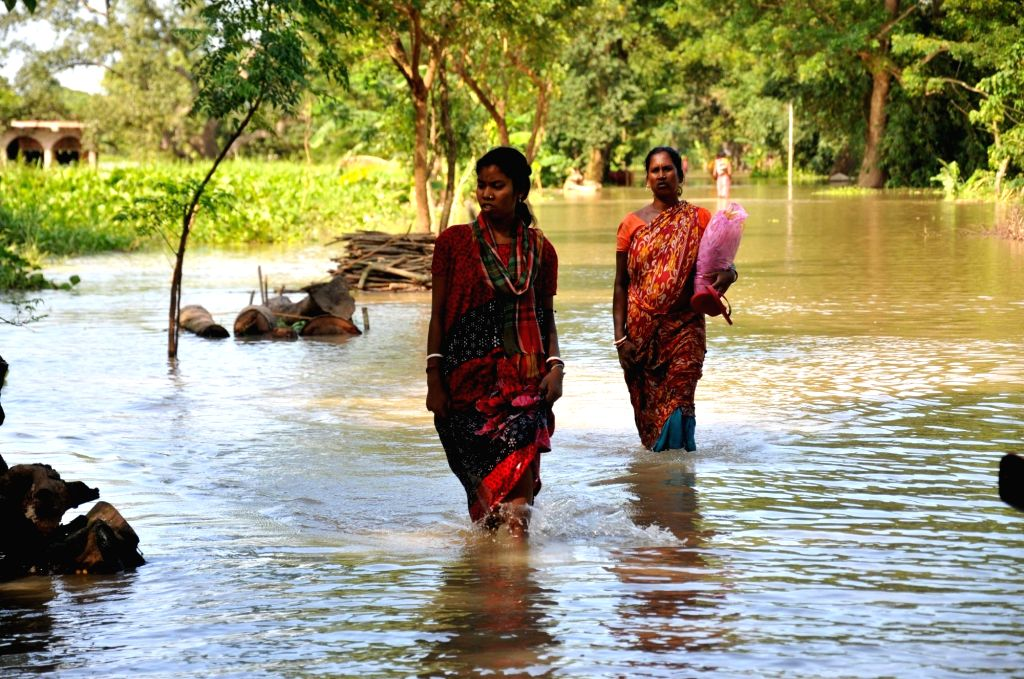 Villegers stand in flood affected area in Howrah District West Bengal on Sunday october 03, 2021.