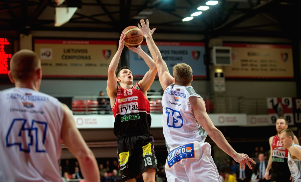 Zygimantas Janavicius (L) of Lietuvos rytas shoots during the Lithuanian Basketball League Championship between Lietuvos rytas from Vilnius and Neptunas from ...