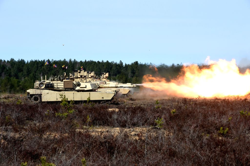 Tanks of U.S. troops stationed in Lithuania are seen during tank live-fire drills in Pabrade, Lithuania, on April 9, 2015. U.S. troops stationed in Lithuania held ...
