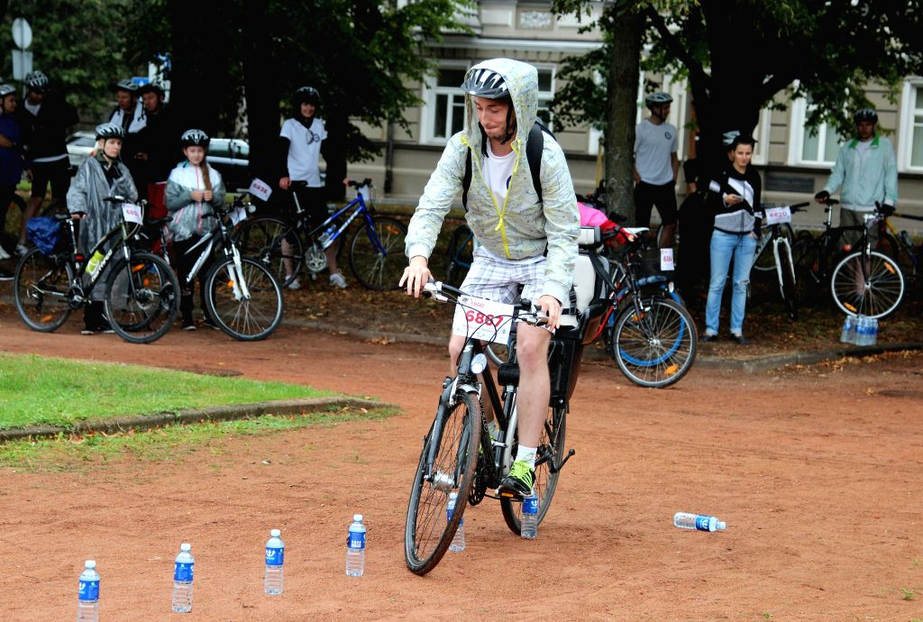 A participant rides a bike before the velomarathon in Vilnius, Lithuania, on Aug 24, 2014. The annual velomarathon starting from 2010 includes three groups for ...
