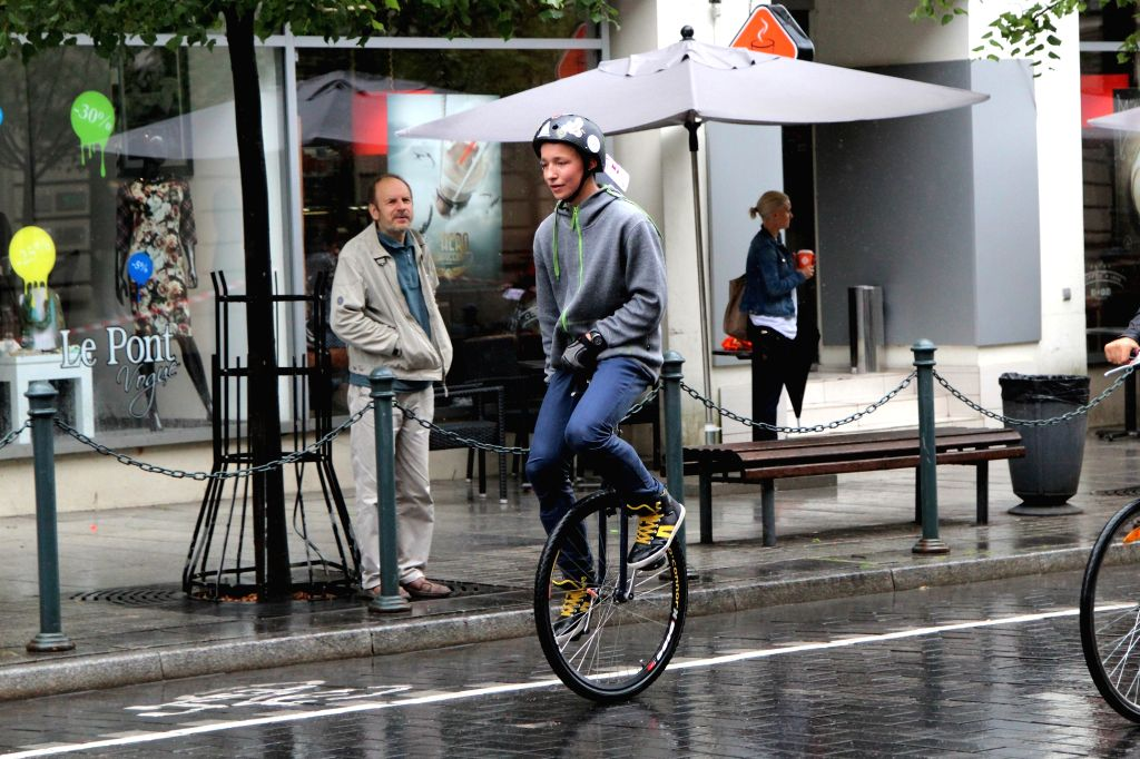 A participant sitting on a monocycle takes part in the velomarathon in Vilnius, Lithuania, on Aug 24, 2014. The annual velomarathon starting from 2010 includes ...
