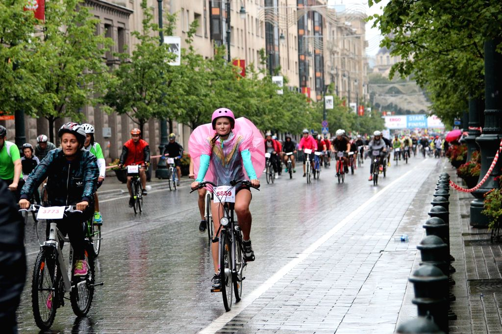 Cycling lovers take part in the velomarathon in Vilnius, Lithuania, on Aug 24, 2014. The annual velomarathon, dating back to 2010, includes three groups for ...