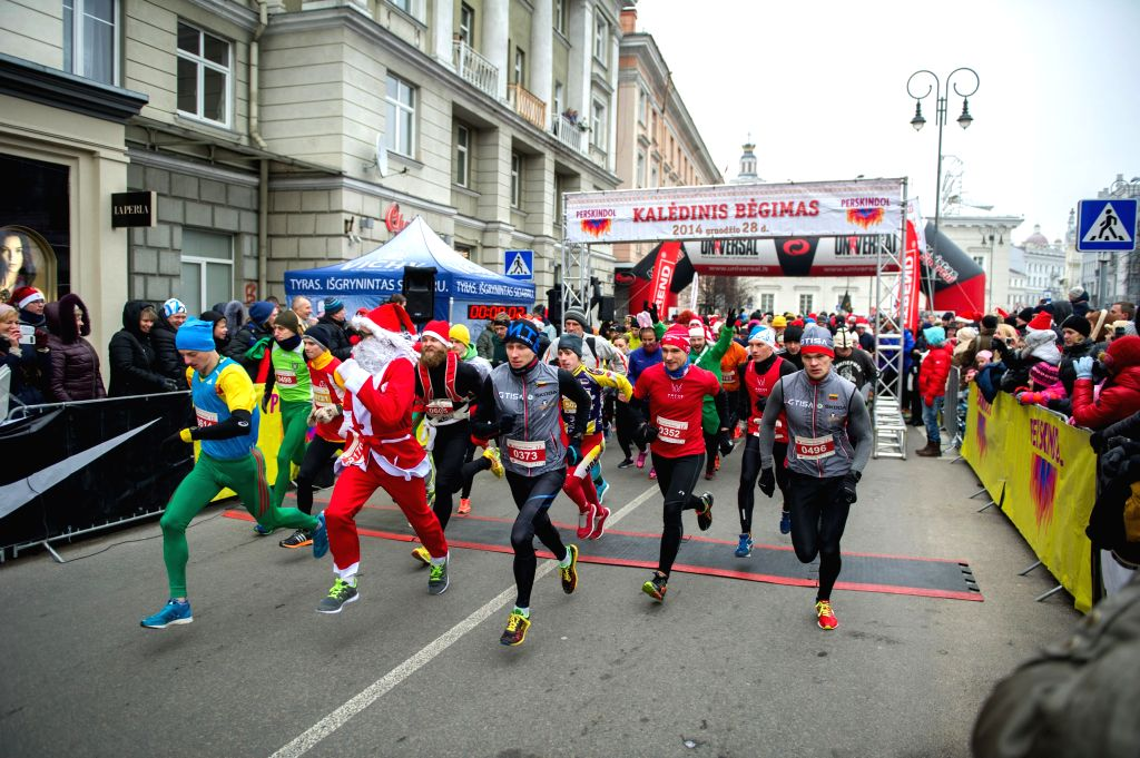 The Christmas race kicks off in Vilnius, Lithuania, Dec. 28, 2014. The Christmas race in Lithuania this year has events of 12km, 6km, and a relay race of 12km for ..