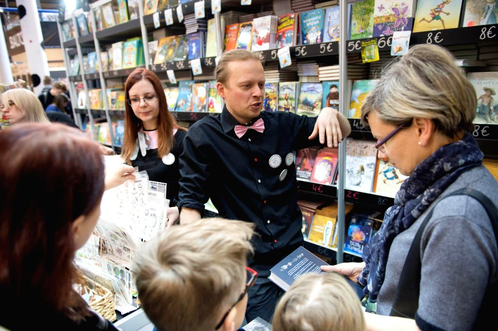 VILNIUS, Feb. 22, 2019 - Visitors choose books at Vilnius Book Fair in Vilnius, Lithuania, Feb. 22, 2019. The annual book fair, being held from Feb. 21 to 24 this year, is one of the largest book ...